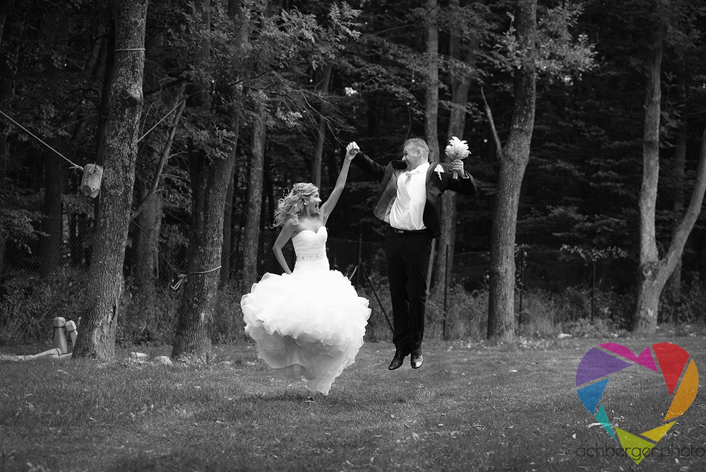 couple wedding jump